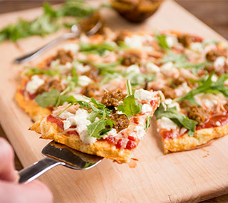 Cauliflower Pizza with Arugula, Chicken and Sun-Dried Tomato Pesto